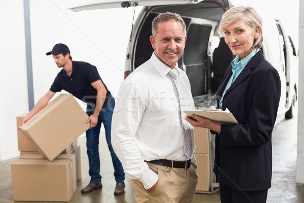 Managers smiling at camera with delivery driver behind Stock photo © wavebreak_media
