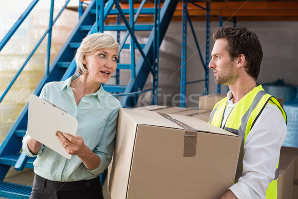 Warehouse manager and worker talking together Stock photo © wavebreak_media