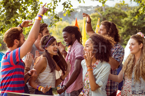 Happy hipsters dancing to the music Stock photo © wavebreak_media