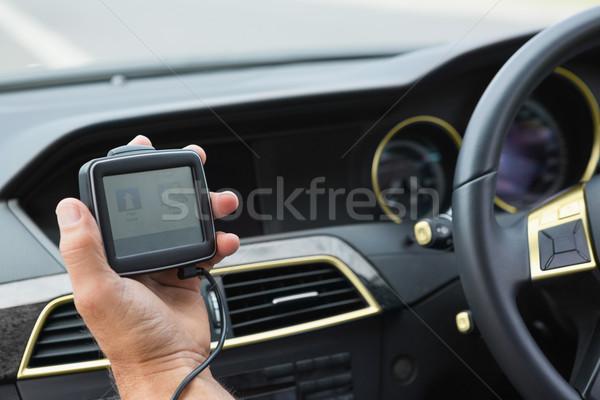 Homme satellite navigation voiture mode de vie séance Photo stock © wavebreak_media