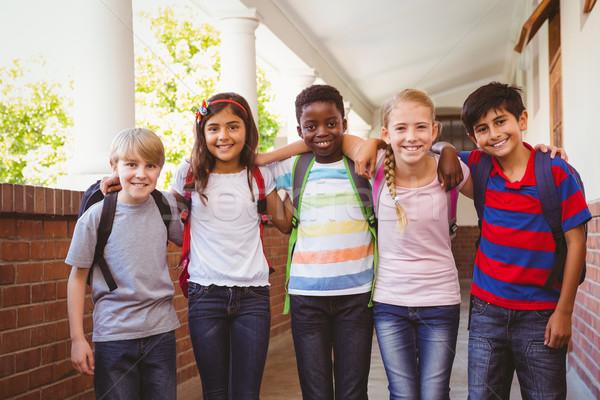 Uśmiechnięty mały szkoły dzieci korytarz portret Zdjęcia stock © wavebreak_media