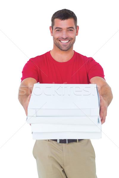 Happy delivery man giving pizza boxes Stock photo © wavebreak_media
