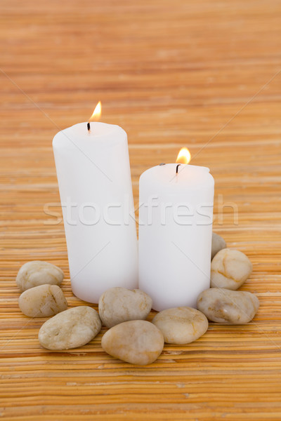 Candles with pebbles Stock photo © wavebreak_media
