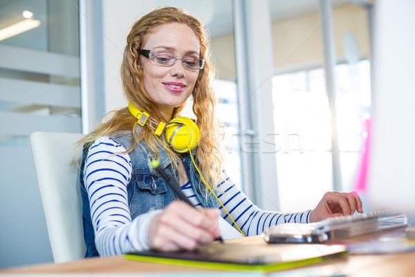 Smiling designer working with digitizer  Stock photo © wavebreak_media
