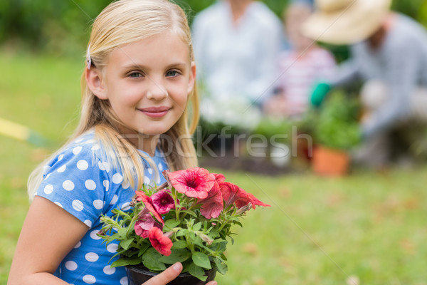 Young girl sitting with flower pot  Stock photo © wavebreak_media