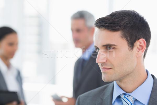 бизнесмен коллеги за служба женщину человека Сток-фото © wavebreak_media