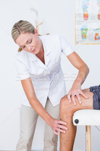 Doctor examining her patient knee Stock photo © wavebreak_media