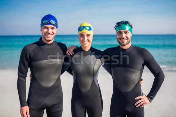 готовый пляж женщину человека морем Сток-фото © wavebreak_media