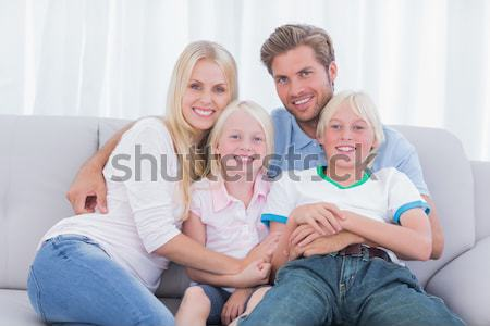Happy parent tickling her cute son on the couch Stock photo © wavebreak_media