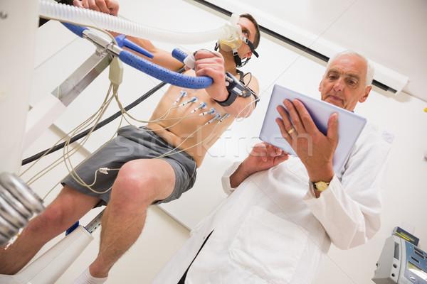 Man fitness test oefening fiets medische Stockfoto © wavebreak_media