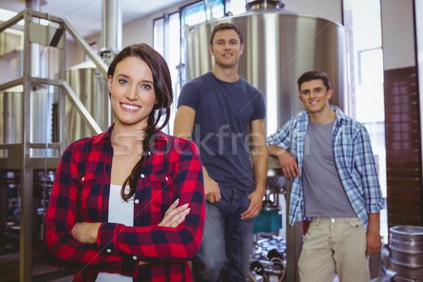Casual happy stylish team smiling at camera together Stock photo © wavebreak_media