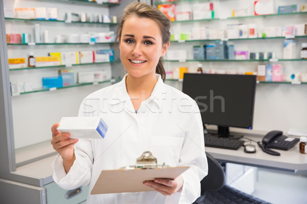 Junior pharmacist holding medicine box Stock photo © wavebreak_media