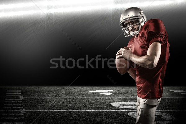 Composite image of serious american football player in red jerse Stock photo © wavebreak_media