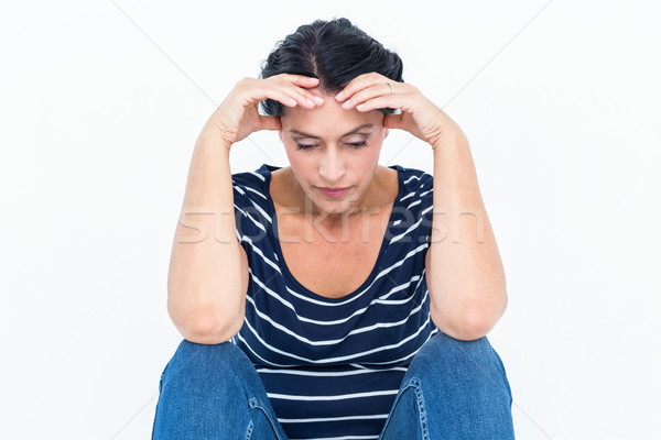 Sad woman sitting with head in hands Stock photo © wavebreak_media