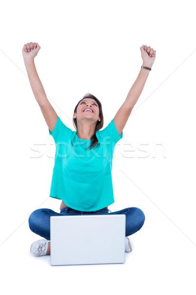 Pretty brunette cheering in front of camera  Stock photo © wavebreak_media
