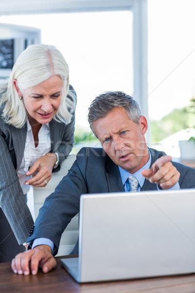 Ernstig zakenlieden werken laptop computer kantoor hand Stockfoto © wavebreak_media