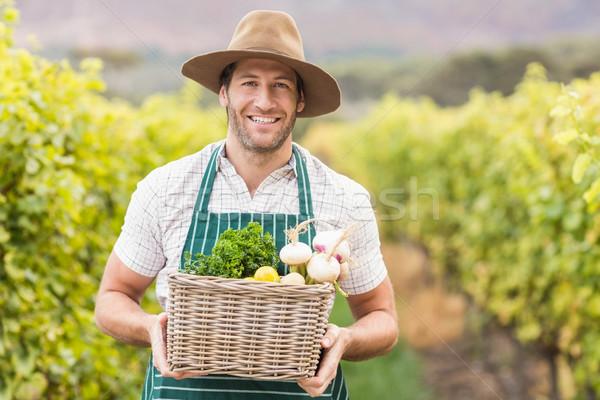 молодые счастливым фермер корзины овощей Сток-фото © wavebreak_media