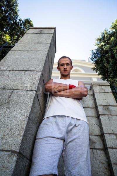 Portret ekstremalnych sportowiec stałego ściany broni Zdjęcia stock © wavebreak_media