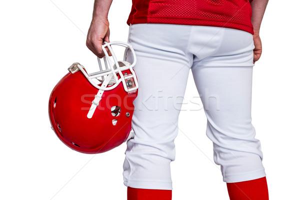 American football player holding a helmet Stock photo © wavebreak_media