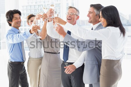 Happy business people celebrating a sucess with hands up Stock photo © wavebreak_media