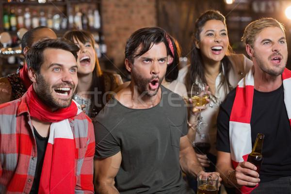 Derűs barátok kiált kocsma másfelé néz buli Stock fotó © wavebreak_media