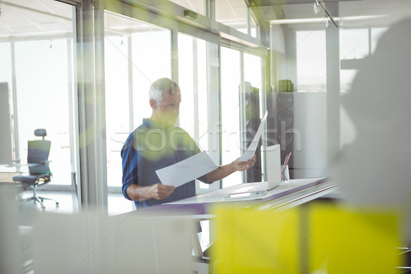 Male interior designer analyzing diagrams on papers Stock photo © wavebreak_media