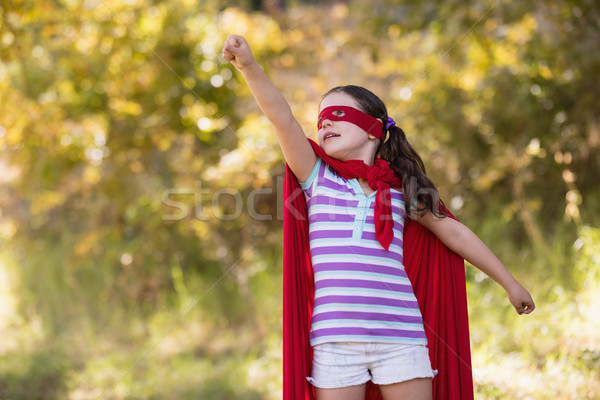 little girl trying to fly while wearing superhero costume Stock photo © wavebreak_media