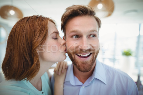 Hartelijk vrouw zoenen man kantoor liefde Stockfoto © wavebreak_media