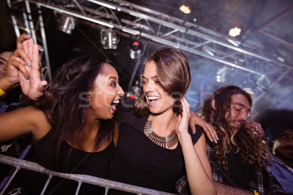 Cheerful female friends enjoying at nightclub Stock photo © wavebreak_media