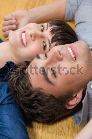 Young woman with boyfriend lying on towel at beach Stock photo © wavebreak_media