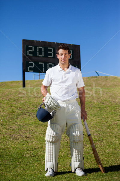 Portrait of cricket player standing against scoreboard Stock photo © wavebreak_media