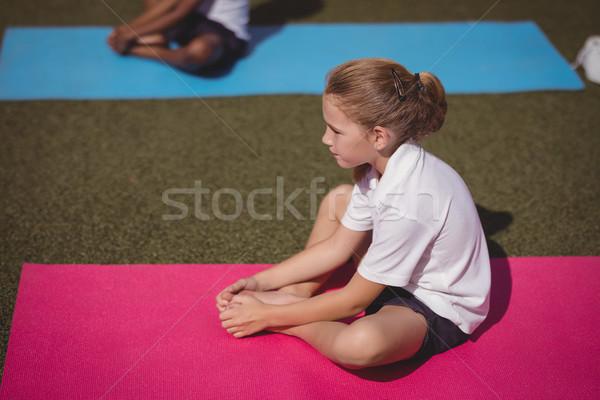 Schoolgirl exercising in schoolyard Stock photo © wavebreak_media
