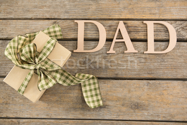 Overhead view of dad text with gift box Stock photo © wavebreak_media