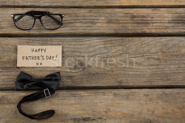 Gelukkige vadersdag tekst bril houten tafel Stockfoto © wavebreak_media