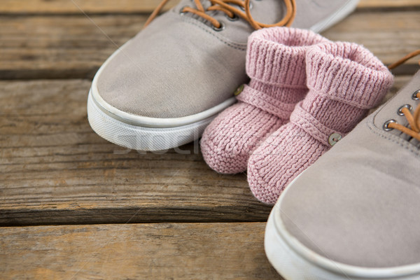 Cropped image of shoes and baby booties Stock photo © wavebreak_media