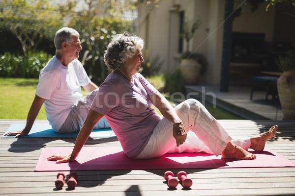 Oldalnézet idős pár testmozgás együtt veranda ül Stock fotó © wavebreak_media