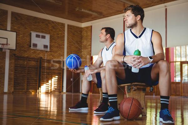 Nachdenklich Basketball Spieler Sitzung Bank Stock foto © wavebreak_media