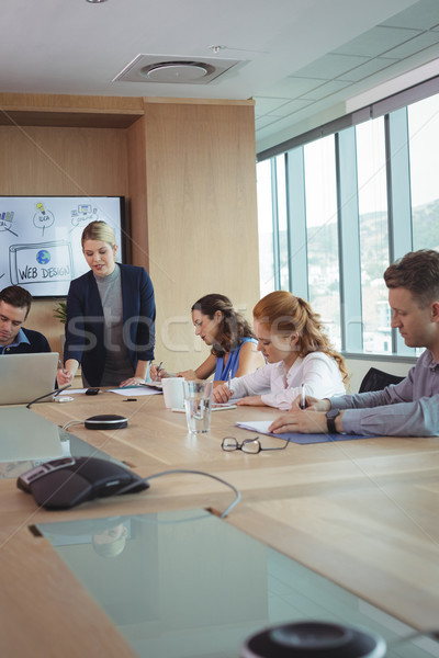 Young businesswoman with team working at conference table Stock photo © wavebreak_media