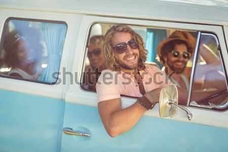 Smiling woman relaxing camper van Stock photo © wavebreak_media