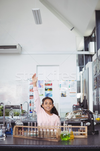Portrait of smiling elementary student with hands raised at science laboratory Stock photo © wavebreak_media