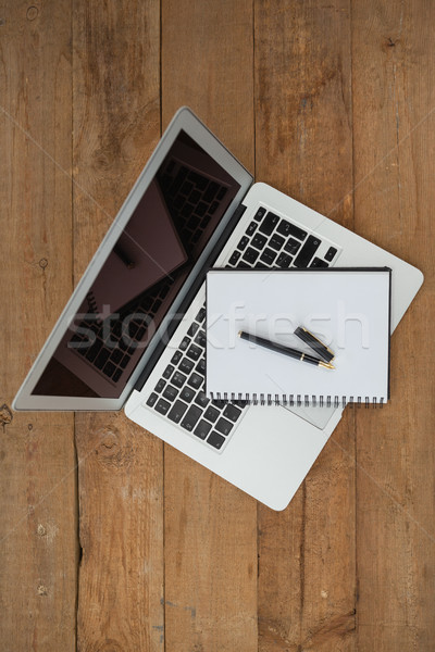 Laptop, pen, and diary on wooden background Stock photo © wavebreak_media