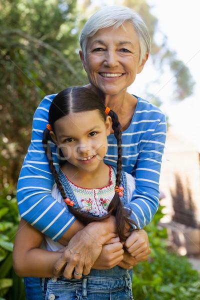 Portrait of smiling senior woman embracing granddaughter Stock photo © wavebreak_media