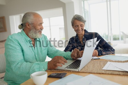 Stock photo: Smiling healthcare worker serving coffee to senior man sitting by friend