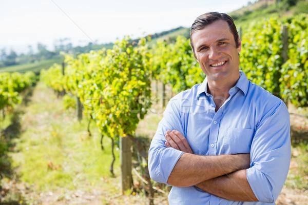 Portrait of smiling vintner standing with arms crossed Stock photo © wavebreak_media