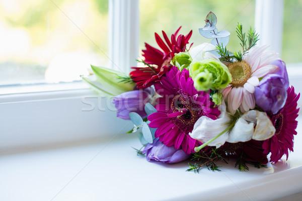 Bouquet of flower kept on window sill Stock photo © wavebreak_media