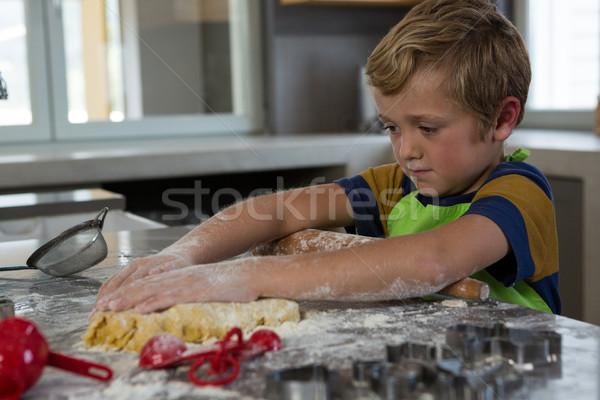 Boy baking dough in kitchen Stock photo © wavebreak_media