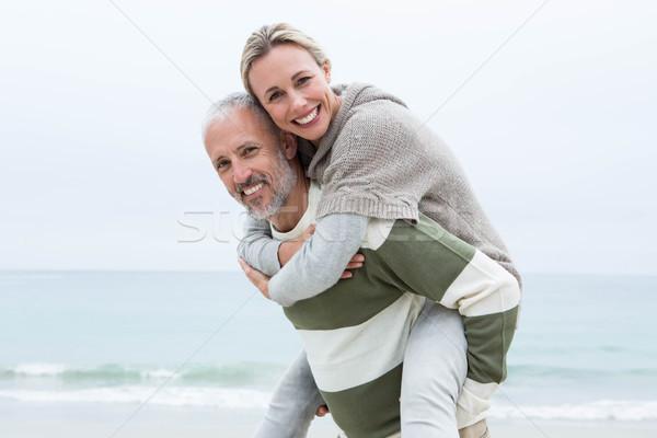 Man giving his partner a piggy back Stock photo © wavebreak_media