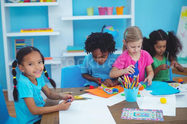 Happy kids doing arts and crafts together Stock photo © wavebreak_media