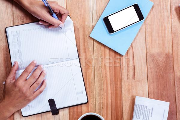 Féminin mains écrit café journal smartphone Photo stock © wavebreak_media