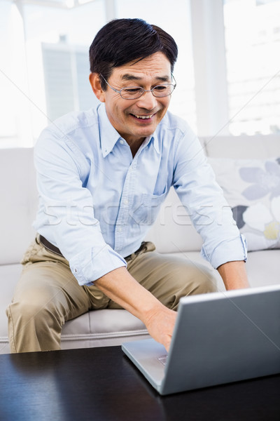 Stock photo: Happy man sitting at home
